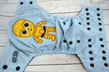 Sparkly Gold Robot (light blue pul, black awj, two toned; black caps, bronze pieces) <br>Embroidered, One Size Pocket Diaper<br>Instock and Ready to Ship