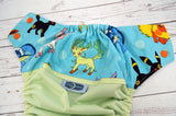 Celery Poke-Creature (celery pul, seaspray awj, two toned; orange caps, kelly pieces) <br>Wrap Around, One Size Pocket Diaper<br>Instock and Ready to Ship