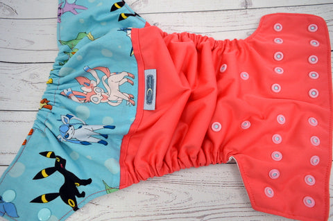 Watermelon Poke-Creature (coral pul, white awj, two toned; seaspray caps, light pink pieces) <br>Wrap Around, One Size Pocket Diaper<br>Instock and Ready to Ship