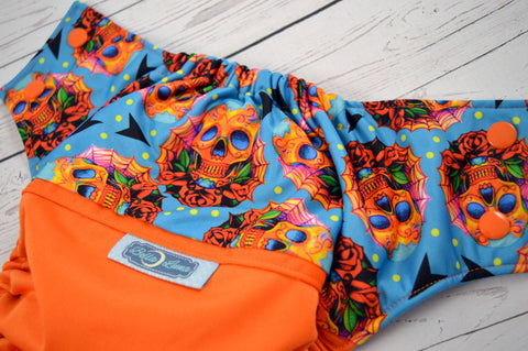 Jack-o-skulls (orange outer,  two-toned snaps - orange caps / aqua pieces)<br>Wrap Around, One Size Pocket Diaper<br>Instock and Ready to Ship