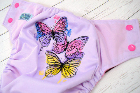 Watercolor Butterflies (lavender outer, two-toned snaps hot pink caps/ aqua pieces)<br>Embroidered, One Size Pocket Diaper<br>Instock and Ready to Ship
