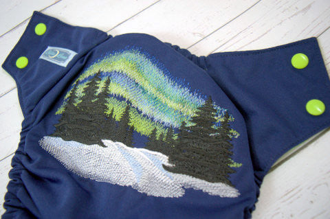 Green Northern Lights (navy outer, apple snaps)<br>Embroidered, One Size Pocket Diaper<br>Instock and Ready to Ship