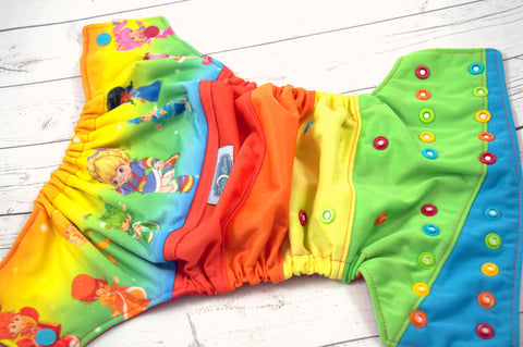 On The Bright Side (white caps, red/orange/marigold/apple/aqua alternating pieces) <br>PK Wrapped Crazy Scrappy, One Size Pocket Diaper<br>Instock and Ready to Ship
