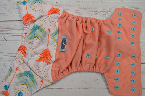 Pastel Arrows (light coral pul, seaspray awj, two toned snaps- aqua caps & seaspray pieces) <br>Wrap Around, One Size Pocket Diaper<br>Instock and Ready to Ship