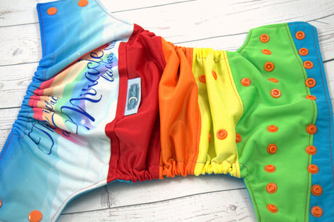 Mircale Looks Like (orange snaps) <br>PK Wrapped Crazy Scrappy, One Size Pocket Diaper<br>Instock and Ready to Ship