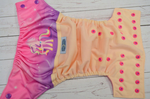 Pretty Pony (ivory outer, raspberry awj, two toned snaps; violet caps, hot pink pieces) <br>Wrap Around, One Size Pocket Diaper<br>Instock and Ready to Ship