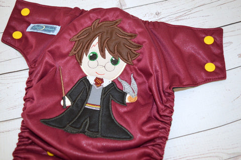 Wizard Boy (burgundy pul, black awj, marigold snaps) <br>Embroidered, One Size Pocket Diaper<br>Instock and Ready to Ship
