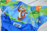 Firefly Tiger (printed pul, spring green awj, two toned snaps; marigold caps, apple pieces) <br>Wrap Around, One Size Pocket Diaper<br>Instock and Ready to Ship