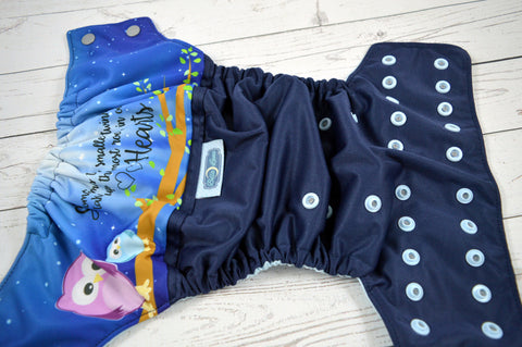 Twinkle in our Hearts ( navy outer, two toned snaps- silver caps, light blue pieces )<br>Wrap Around, One Size Pocket Diaper<br>Instock and Ready to Ship