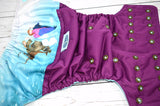 Watercolor Ice Friends (plum outer, seaspray inner, two toned snaps; seaspray caps, bronze pieces)<br>Wrap Around, One Size Pocket Diaper<br>Instock and Ready to Ship