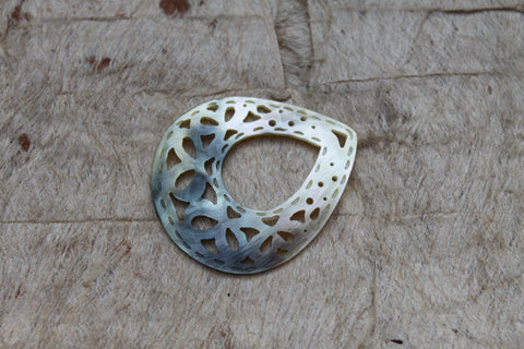 Mother of pearl carved teardrop shell