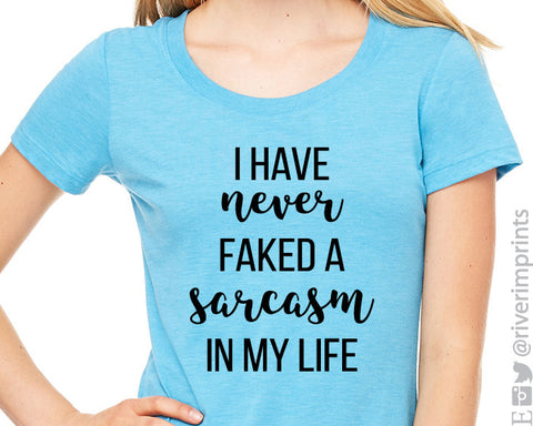 I HAVE NEVER FAKED A SARCASM IN MY LIFE triblend graphic t-shirt