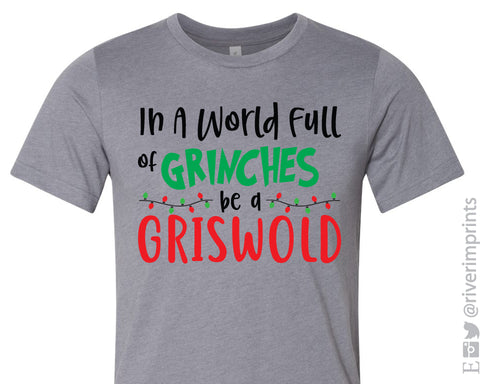 IN A WORLD FULL OF GRINCHES BE A GRISWOLD Graphic Blend Tee