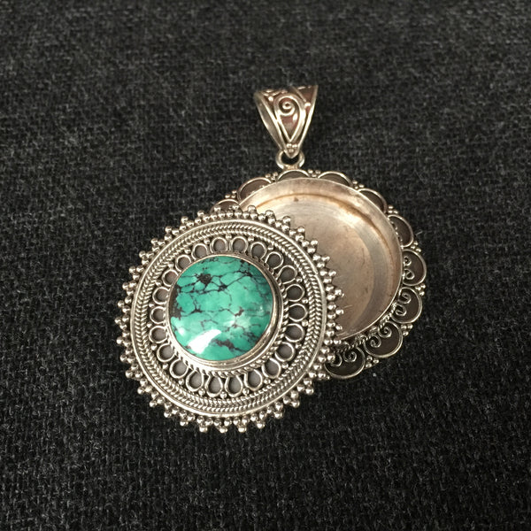 Detailed Handmade Himalayan Turquoise and Silver Pendant Jewelry at Mahakala Fine Arts