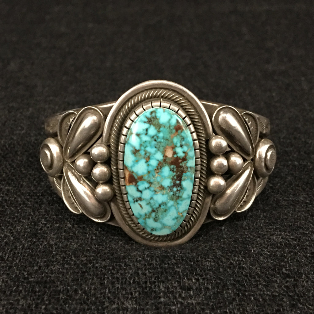 Native American Indian Navajo handmade sterling silver turquoise cuff bracelet by Rick Martinez at Mahakala Fine Arts
