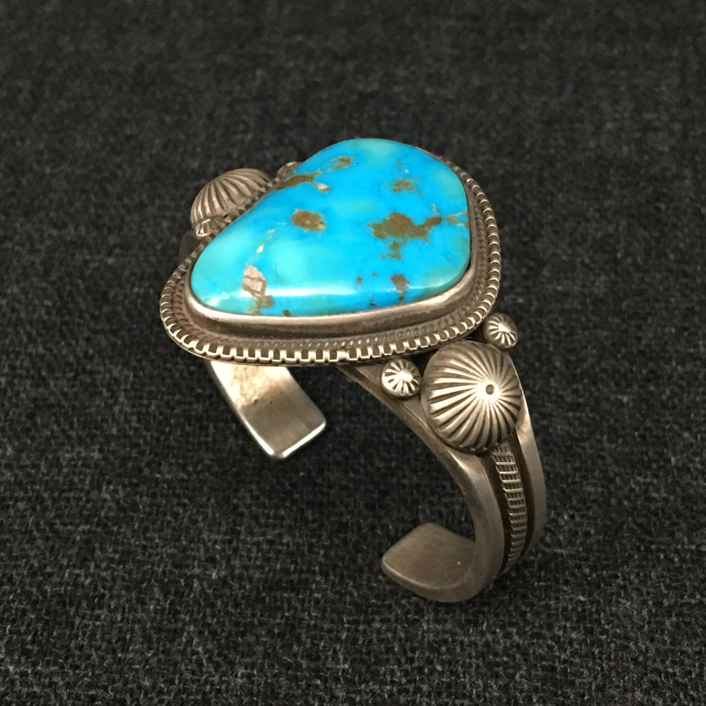 Native American Indian Navajo handmade sterling silver turquoise cuff bracelet by Calvin Martinez at Mahakala Fine Arts