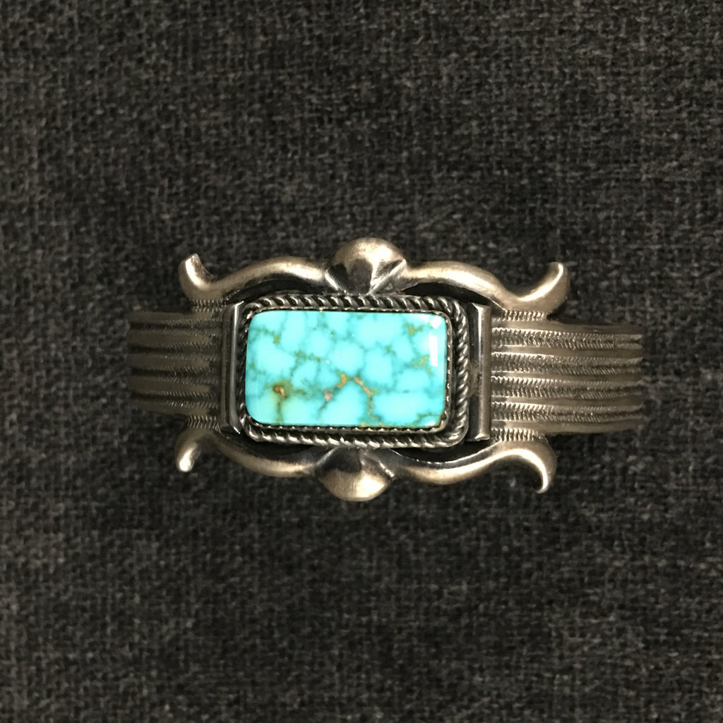 Native American Indian Navajo handmade sterling silver turquoise bracelet by E.S. Mitchell at Mahakala Fine Arts