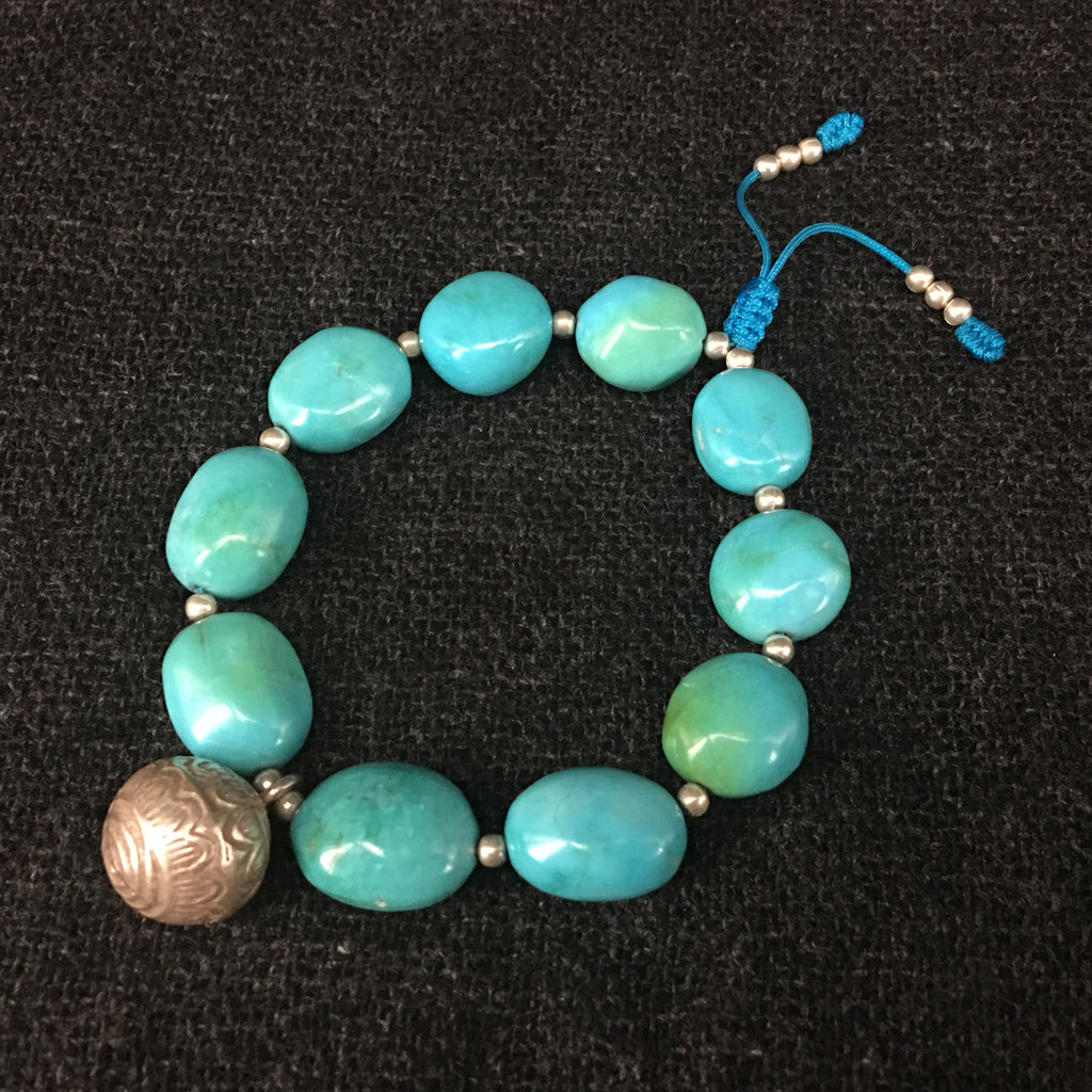 Sleeping Beauty Turquoise Bracelet and Silver Bell Jewelry at Mahakala Fine Arts