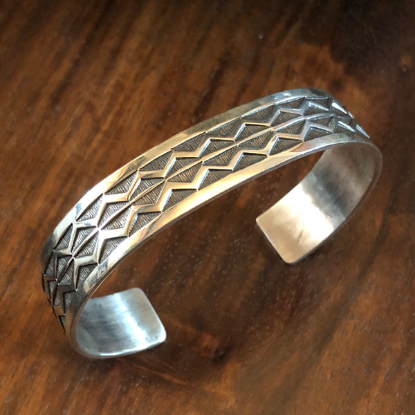 Hand stamped Sterling Silver Bracelet by Navajo Silversmith Sunshine Reeves at Mahakala Fine Arts