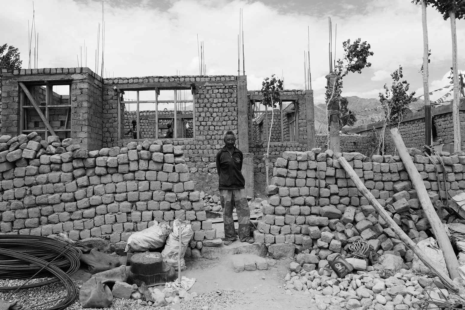 Settled nomad Jigmet in front of his house during construction.