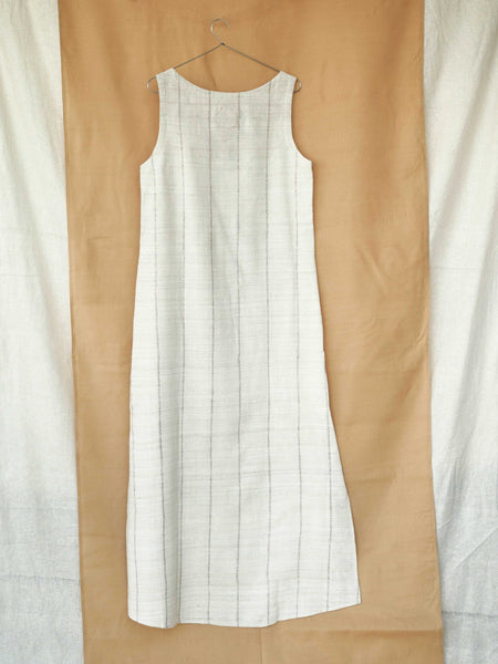 Handspun and handwoven eri silk dress in a cream color with beige stripes. Naturally dyed with teak leaves. 100% natural fiber. Ethically made, slow fashion.