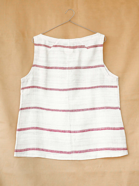 Handspun and handwoven eri silk top in a pink and cream color. 100% natural fiber and naturally dyed with lac. Ethically made, slow fashion, simplicity.