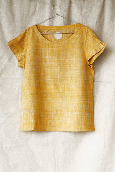 Handspun and handwoven eri silk shirt in a yellow color. 100% natural fiber and naturally dyed with turmeric. Ethically made, slow fashion, simplicity.