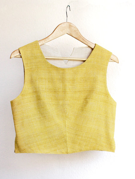 Handspun and handwoven eri silk top in a yellow color. 100% natural fiber and naturally dyed with turmeric. Ethically made, slow fashion, simplicity.