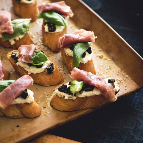Prosciutto, Basil, Goat Cheese & Fig Cake Crostinis