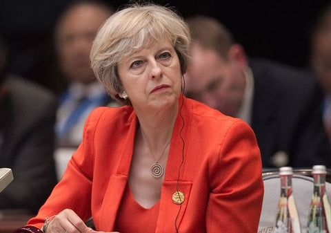 Theresa May red suit  gold jewelry | blingtalks