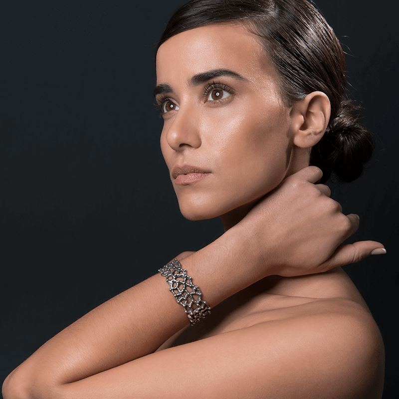 Cuff Bracelet made of Oxidised Sterling Silver named Geomorphic - photo of jewelry with model