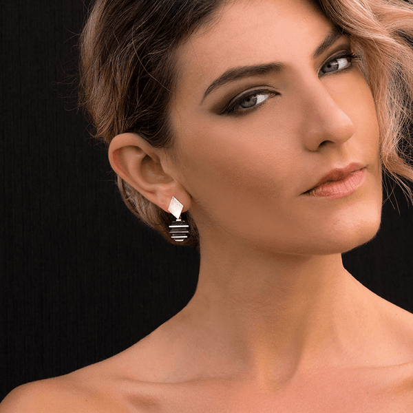 Dangle Earrings made of Sterling Silver named Skyscraper's Edge - photo of jewelry with model