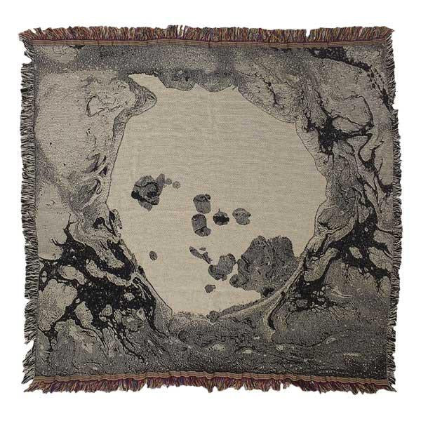 A MOON SHAPED POOL BLANKET