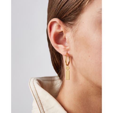 Gold personalized initial letter Modernist Monogram hoop earrings by JENNY BIRD