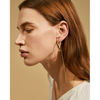 Gold drop Paloma Strikes earrings by Jenny Bird