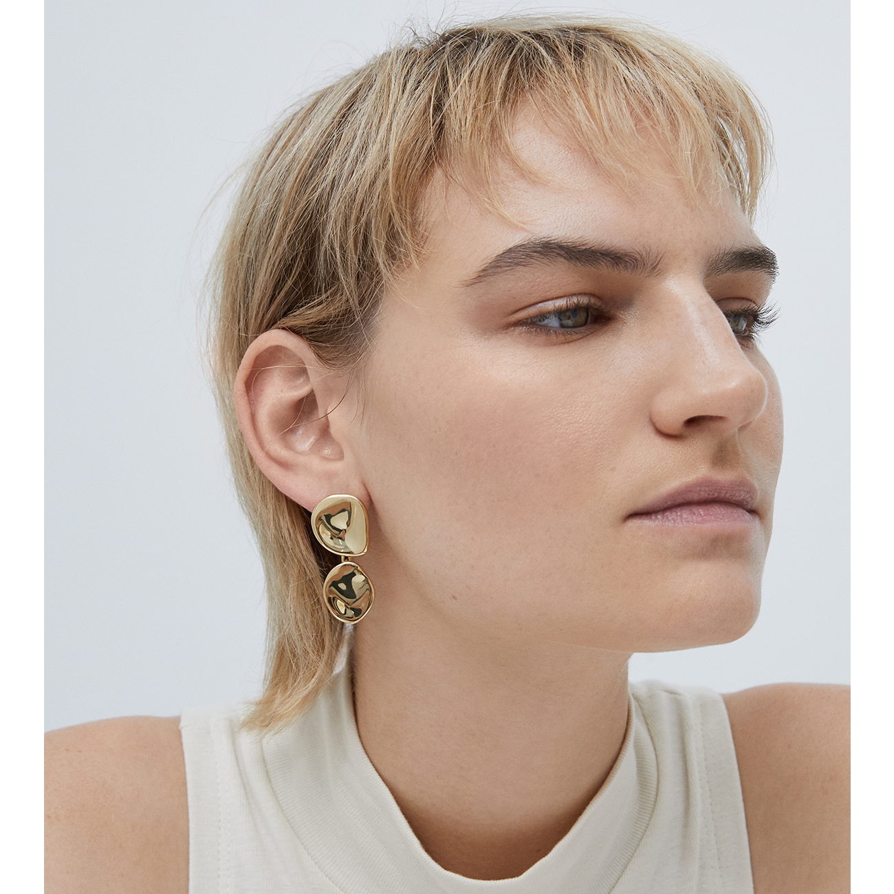 Round, natural shaped drop Mithras earrings in gold by JENNY BIRD