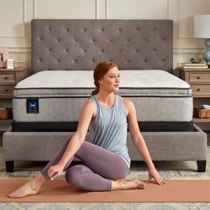Sealy Clement Soft Pillowtop Mattress In Bedroom Woman Stretching