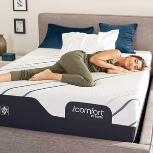 Woman Relaxing in Bedroom on Serta iComfort CF4000 Firm Mattress