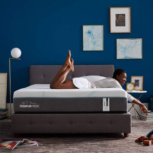 TEMPUR-Adapt Medium Hybrid Mattress Room Shot with Girl Relaxing on Bed