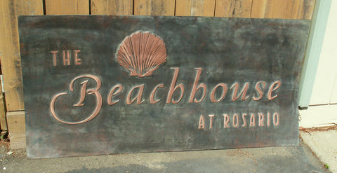 large custom copper logo sign for Rosario resort