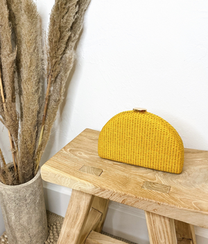 Rounded Yellow Whicker Clutch