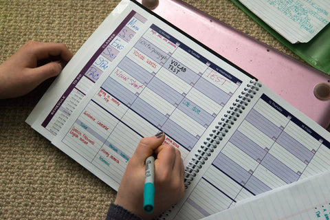 personal-size academic planner in action