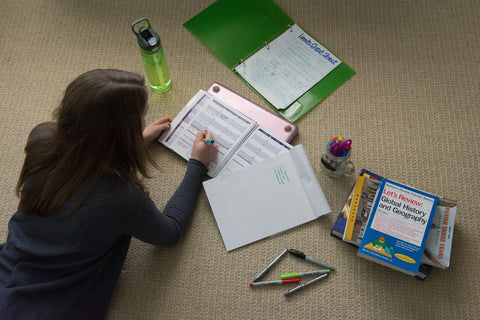 student using personal-size academic planner