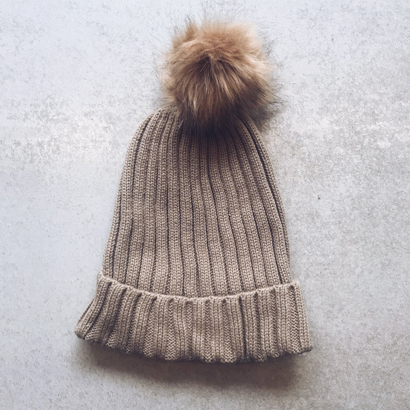 khaki beanie with fur pom pom