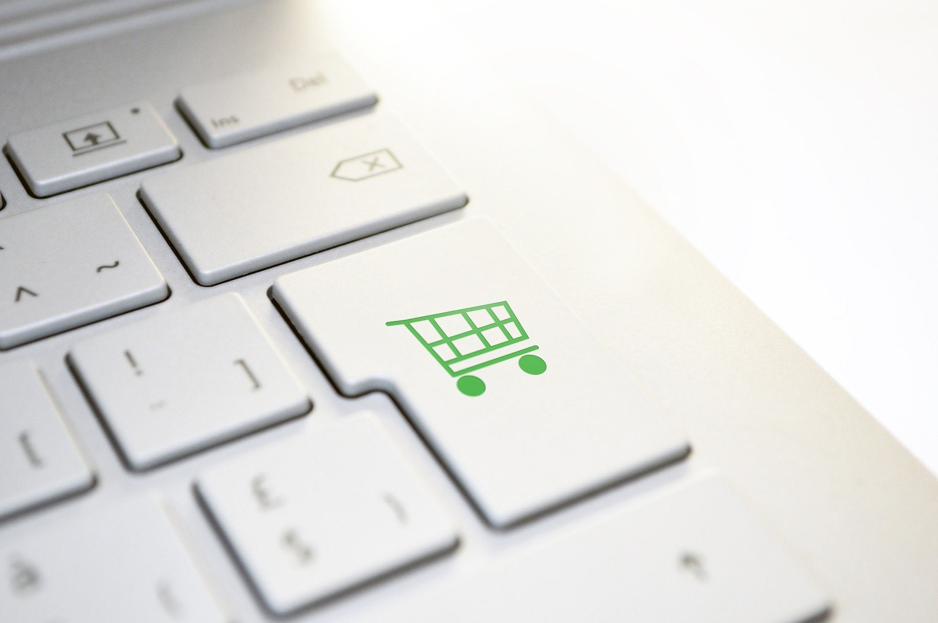 Keyboard with shopping cart button.