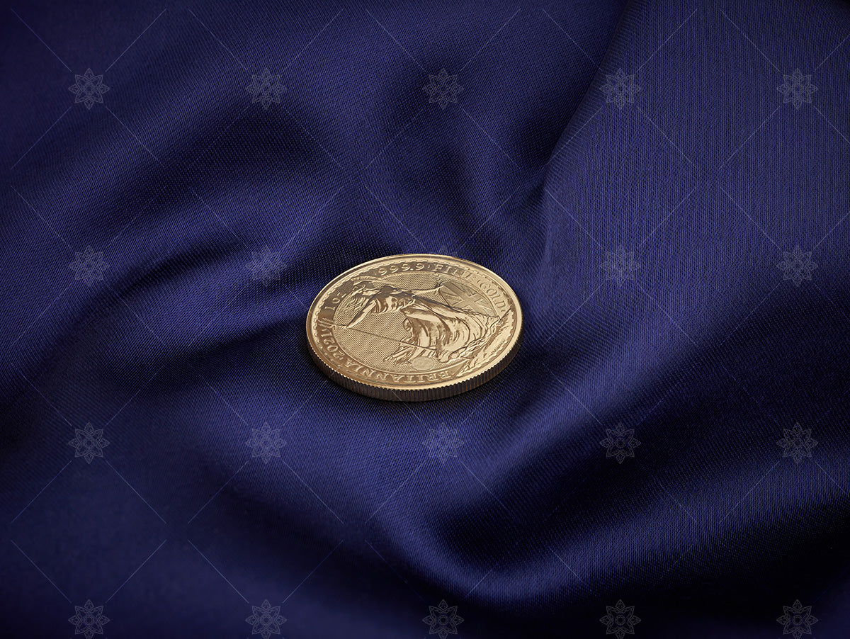Gold Bullion coin on blue silk