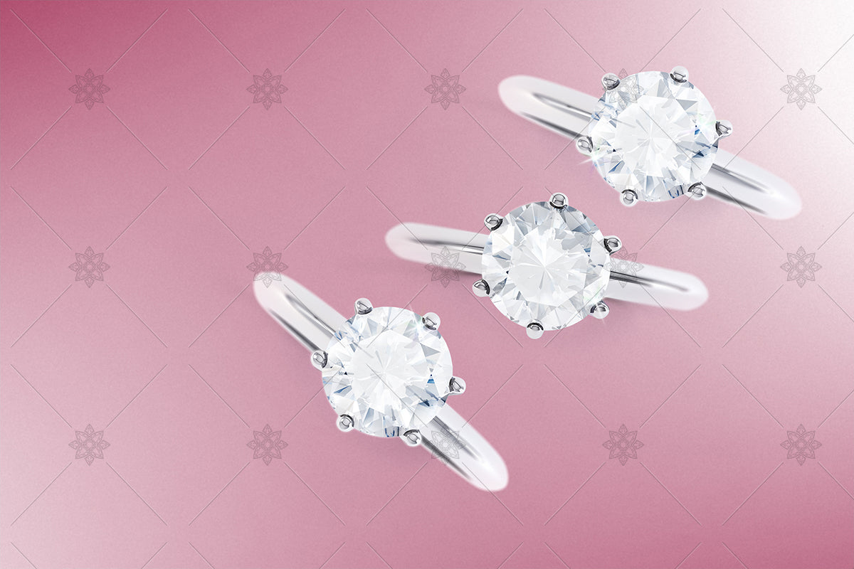 diamond rings top view on pink background