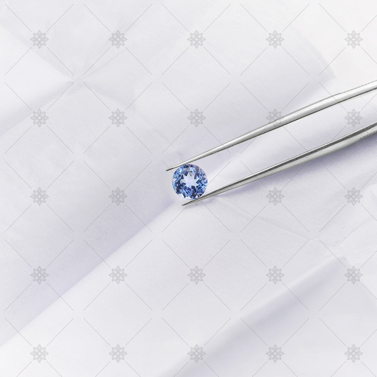 round tanzanite in a parcel