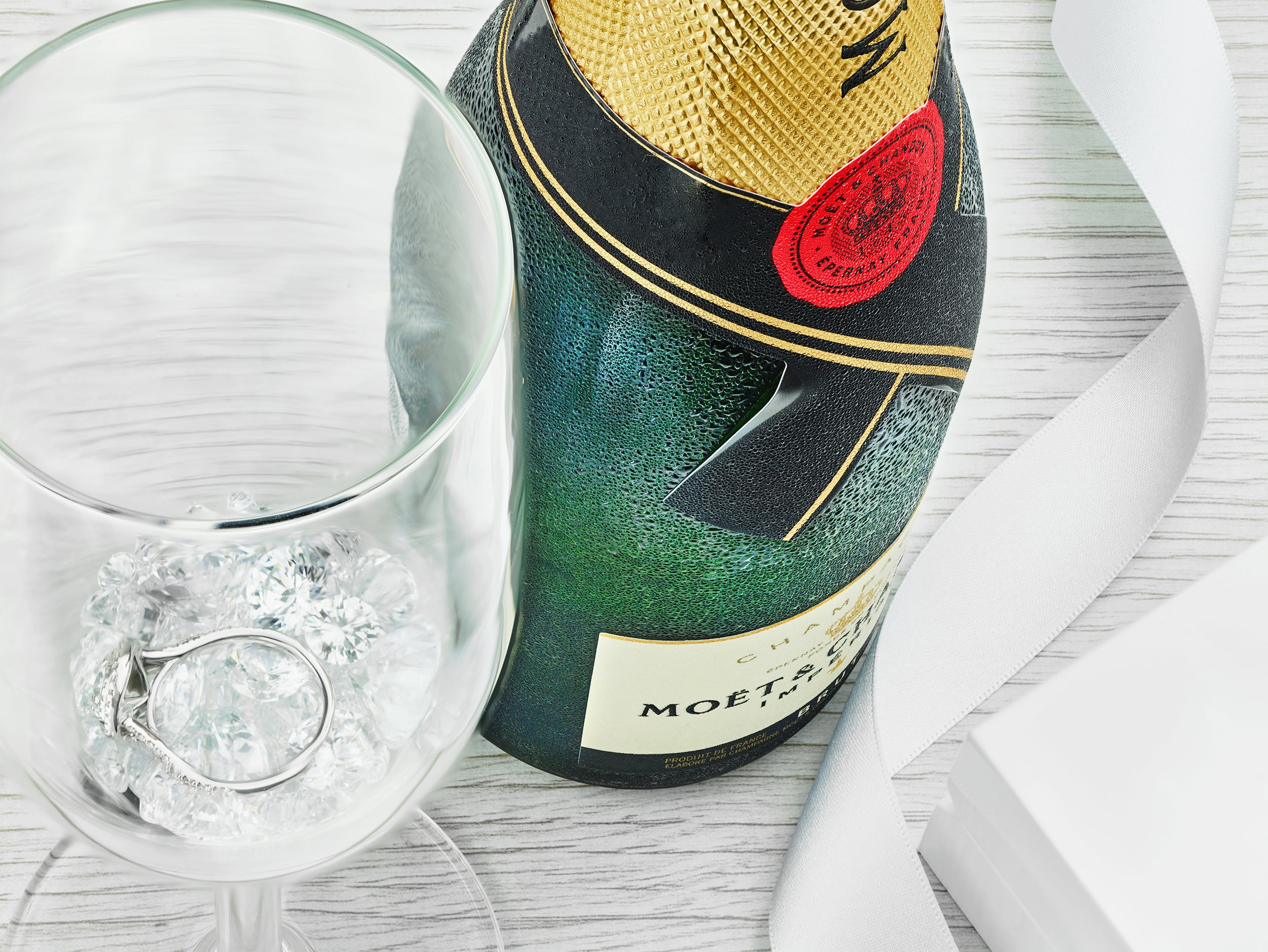 Image of champagne bottle and diamonds