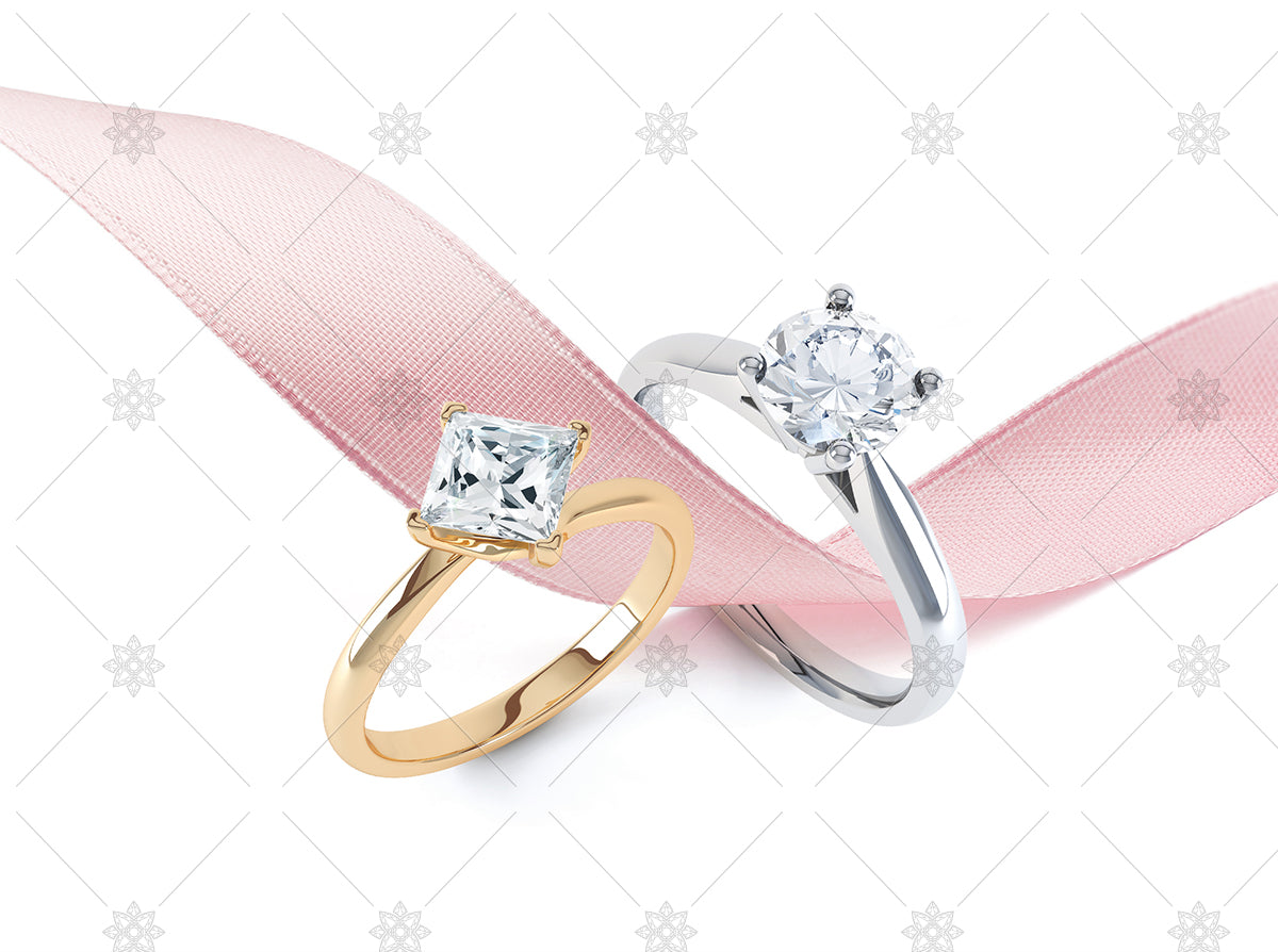 Diamond rings with pink ribbon stock image
